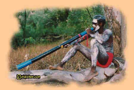An Aboriginal Didgeridoo Player in the Australian  bush