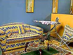 The House of Aboriginality's lounge room – 100% furnished with pseudo-Aboriginal goods.