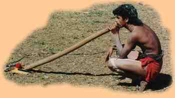 an Aboriginal didgeridoo player at a traditional ceremony